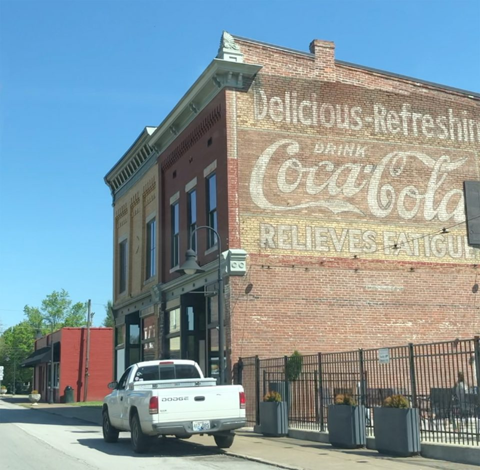 I found this old Coca-Cola wall ad in the small town of Guthrie, Kentucky. A local gentleman told me it dates to 1912, although I haven't verified that. I appreciate that it's still faded and has not had a modern retouch.