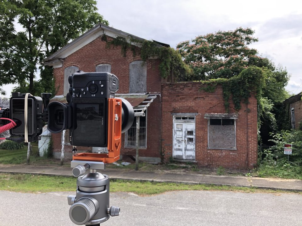 Keith Dotson's camera positioned in the middle of Main Street in Pamplin City Virginia, pointed at one of nearly a dozen abandoned old buildings.