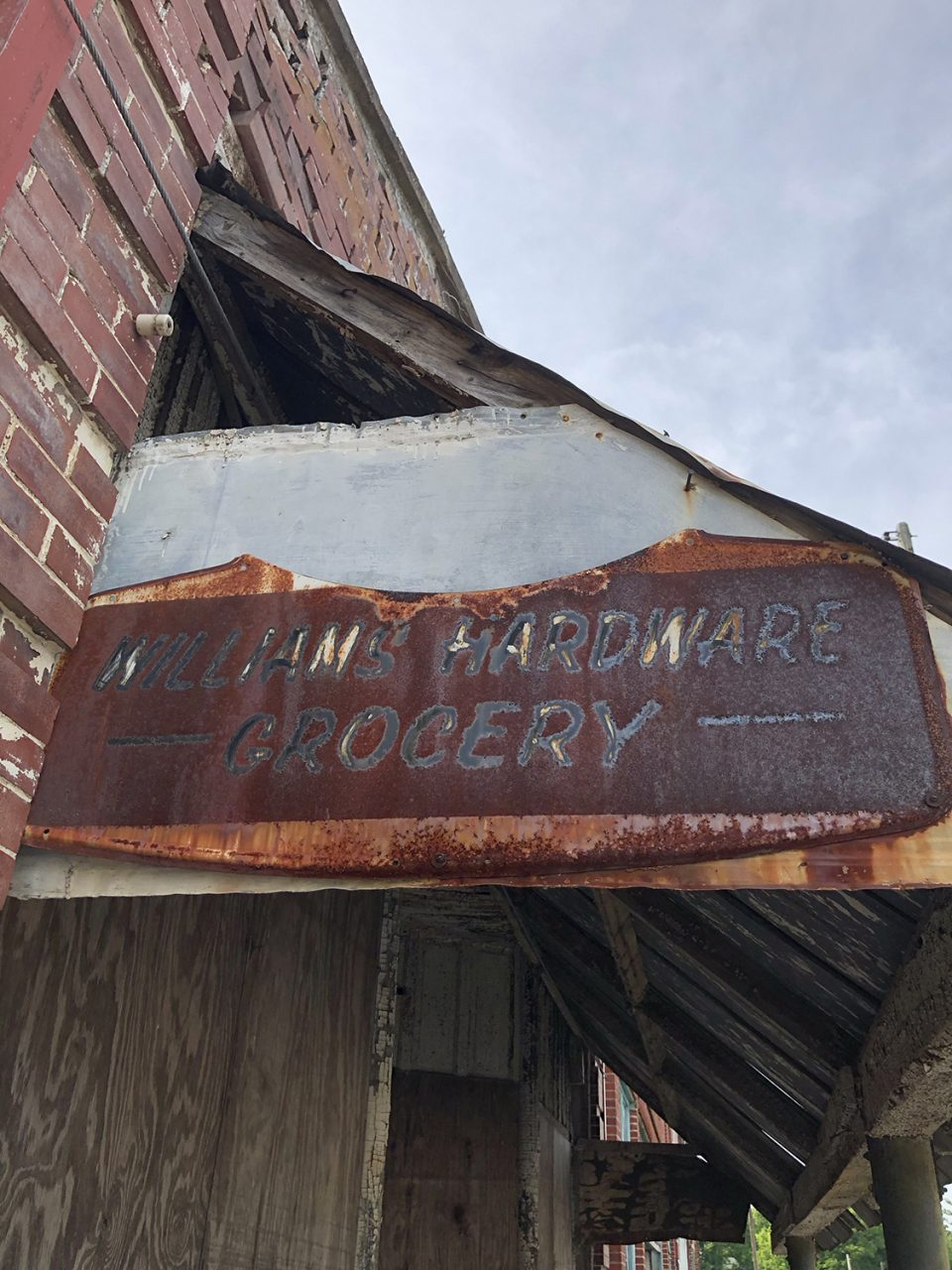 A closer look at the rusty Williams Hardware and Grocery sign. These are the only remaining signage on any of Pamplin's Main Street storefronts.