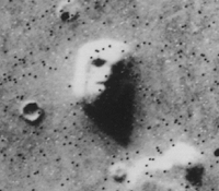 NASA photograph from the Viking mission of a rock formation that resembles a human face.