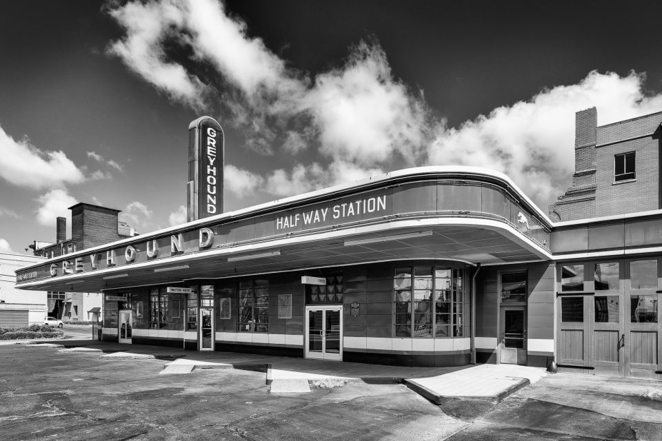 Black and white photograph of the historic Greyhound Bus Station in Jackson, Tennessee, built 1938. Fine art prints are available.