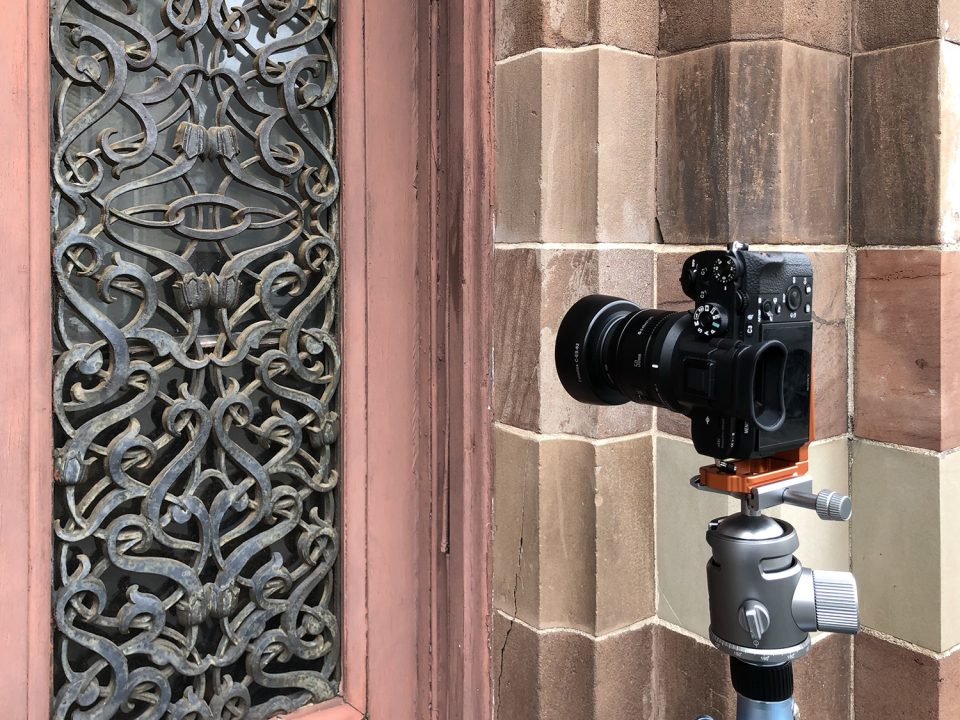 Camera on tripod to photograph the decorative ironwork on the front doors of the Farmers and Exchange Bank on East Bay Street in Charleston, South Carolina