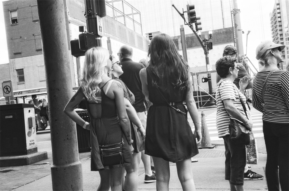 A photograph of pedestrians on the streets of Nashville.