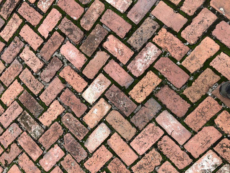 Herringbone brick pattern in the work yard behind the big house
