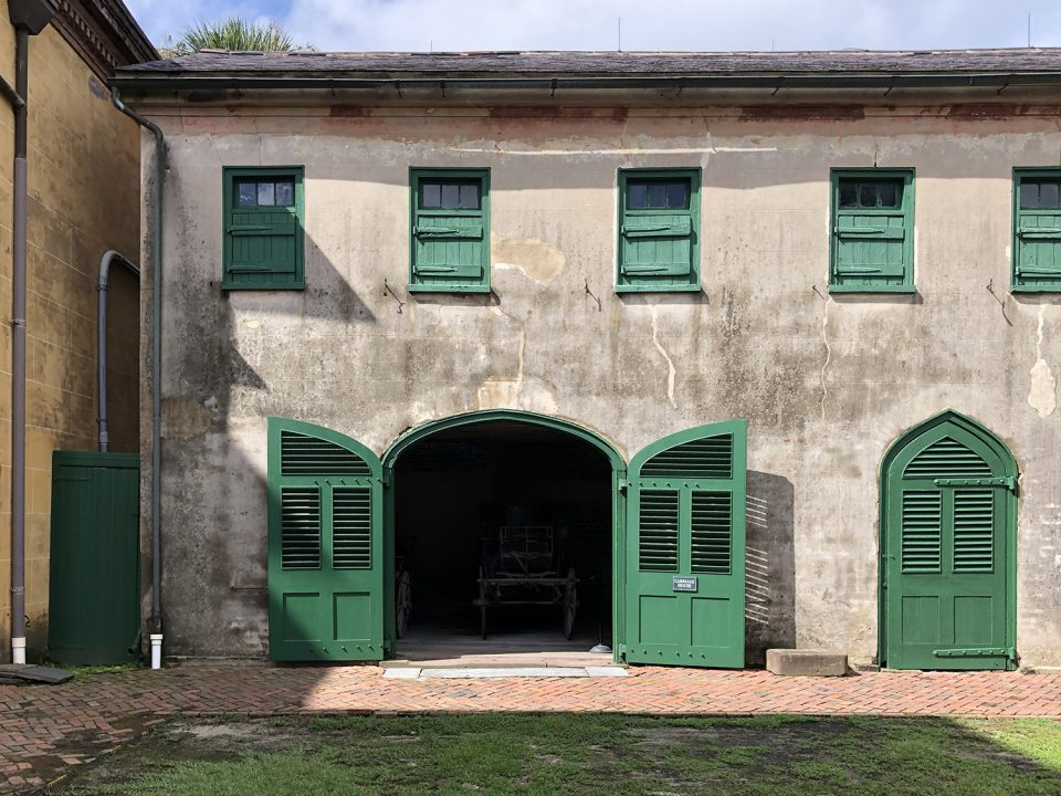 View of the carriage house and stables.