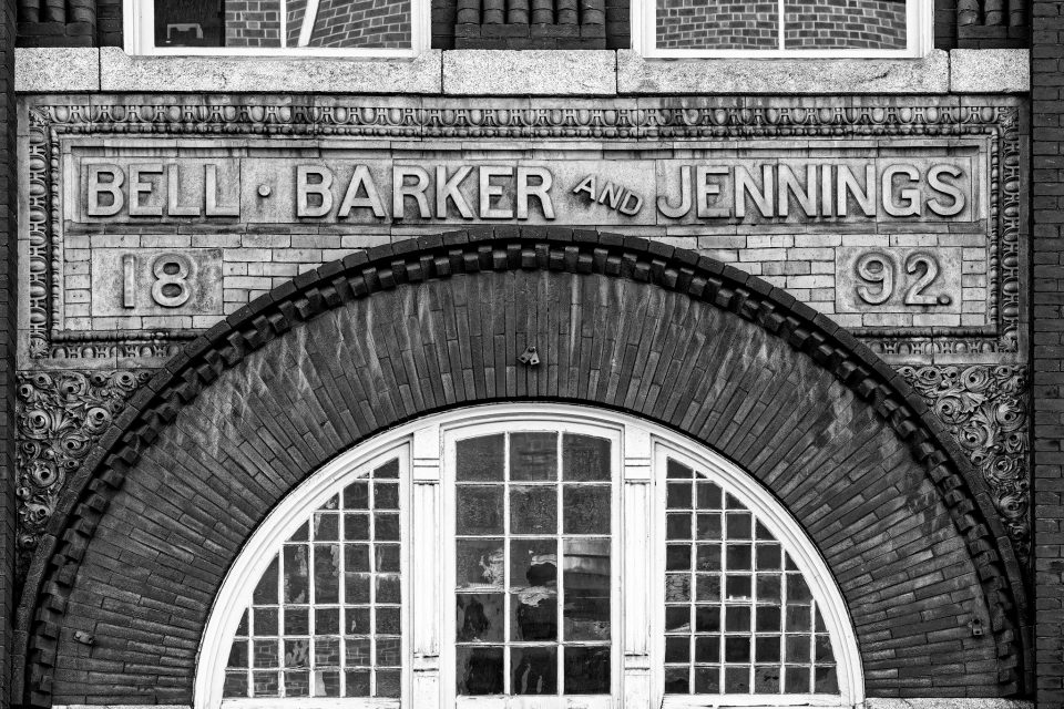 Old Sign for Bell, Barker, and Jennings (1892) on the front of an office building in Lynchburg Virginia.