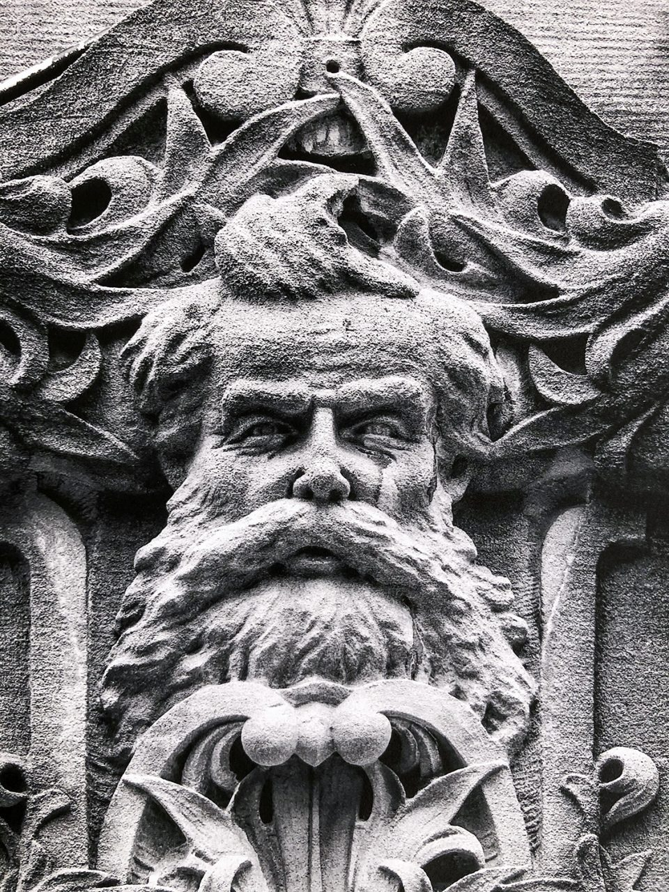 Real life character, florist Cyrus T.C. Deake was immortalized in stone on the Drhumor building in Asheville