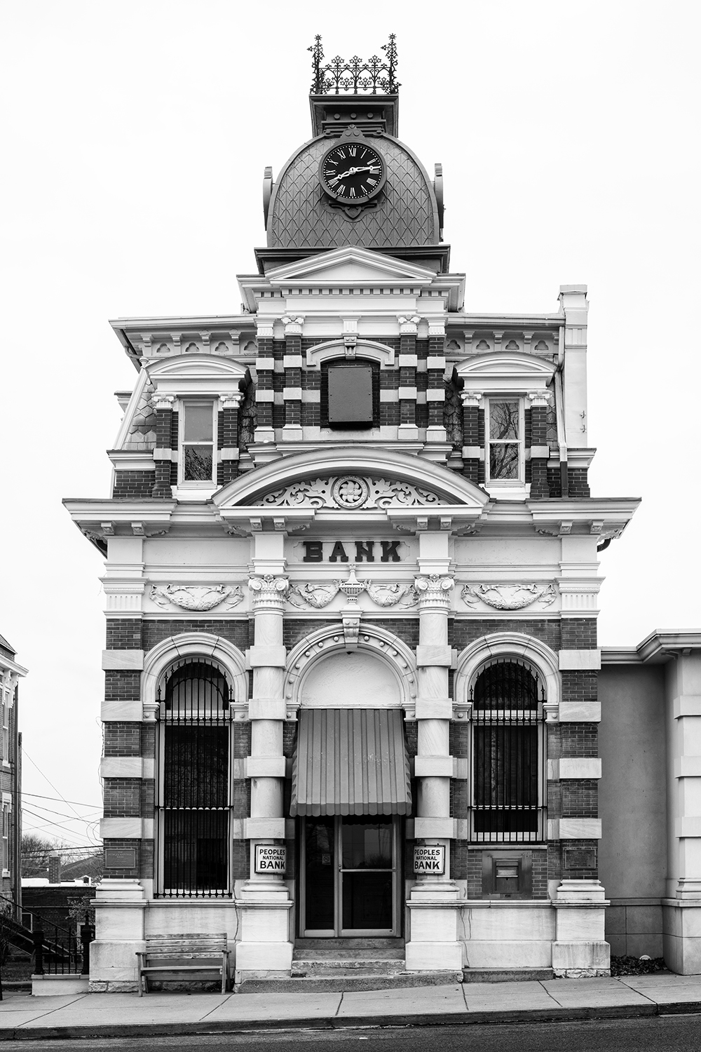 Historic Cloud State Bank Building in McLeansboro, Illinois - Black and White Photograph by Keith Dotson.