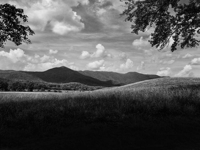 View of the Smoky Mountains across Cades Cove. Car accidents are the leading danger in America's most heavily visited national park.