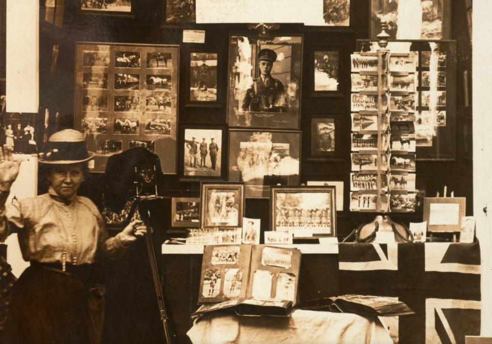 Detail of a portrait of Christina Broom at her postcard stall number 137, operating under the name of Mrs. Albert Broom. Image courtesy of the Museum of London,