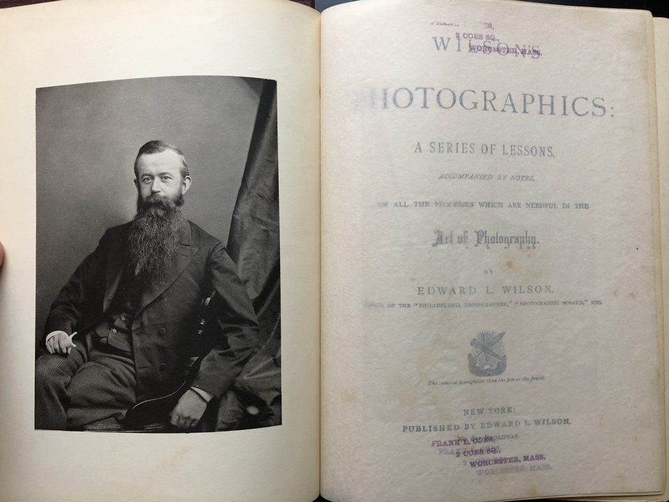 Portrait of author Edward L. Wilson on the frontispiece, across from the title page of Wilson's Photographics, which can be seen through a tissue flysheet.