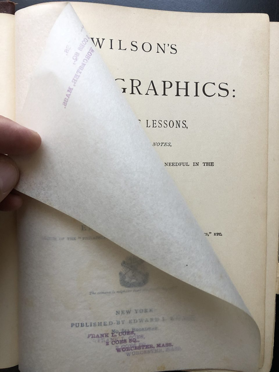 The title page and tissue flysheet from the 1881 publication Wilson's Photographics.