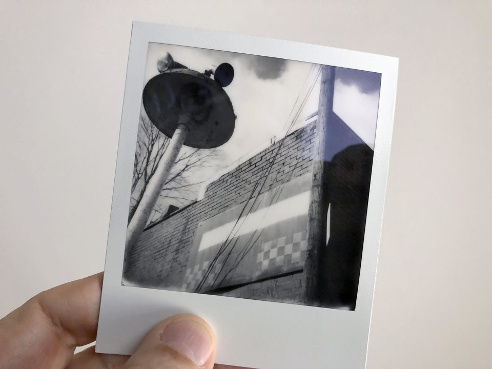 Black and white Polaroid photograph of an old general store, shot on SX-70 instant film. Photo by Keith Dotson.