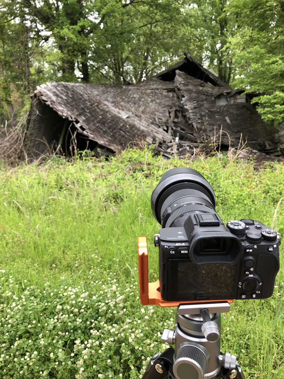 Photographing the partially collapsed old house in Hushpuckena, Mississippi. The peak visible on the left once stood above the post office portion of the house. In the video, we peek inside the old house through a window. Photograph copyright 2021 by Keith Dotson. All rights reserved.