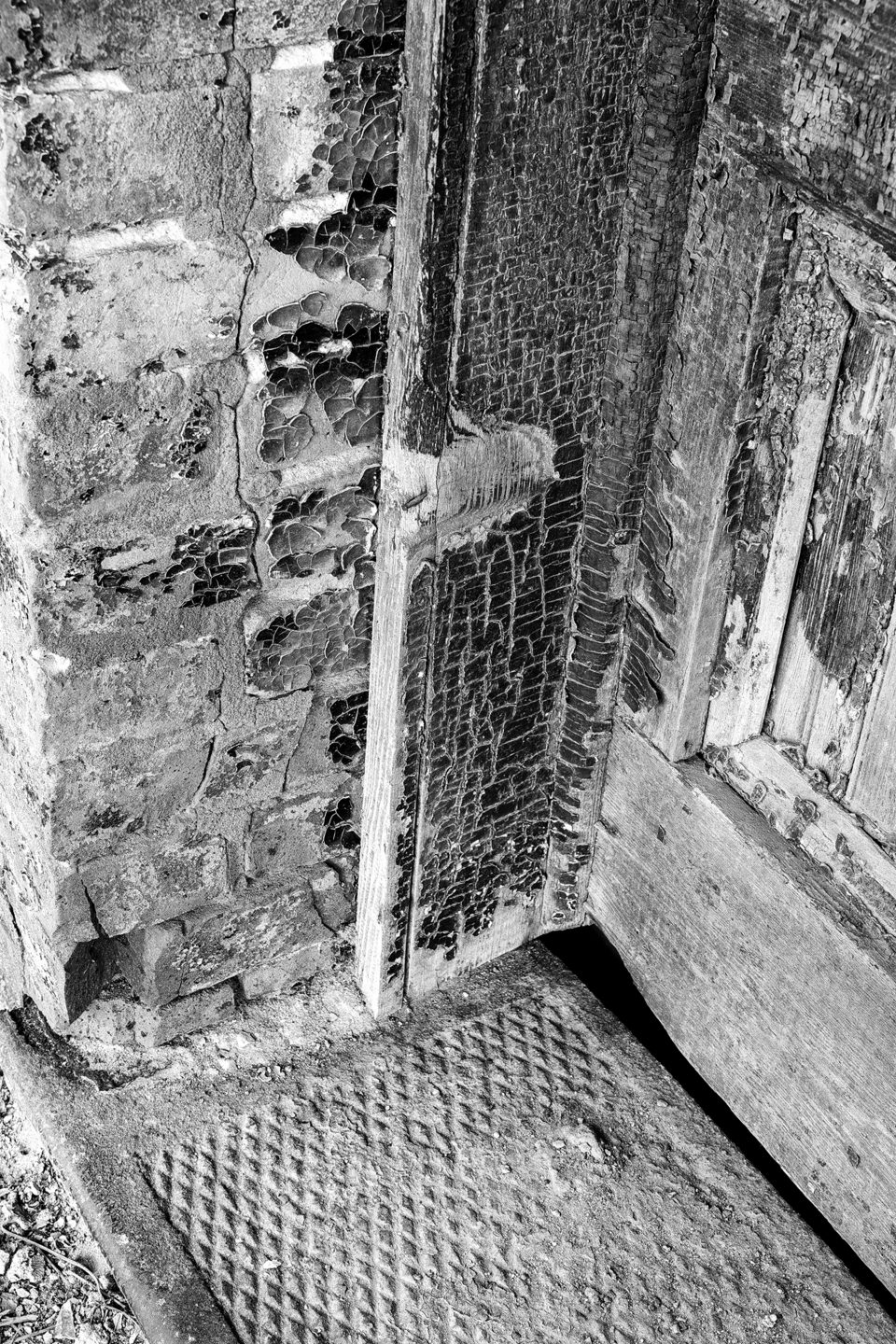 Detail photograph of the iron and wood door step of the R.C. Tibbs & Sons building in Hushpuckena, Mississippi.