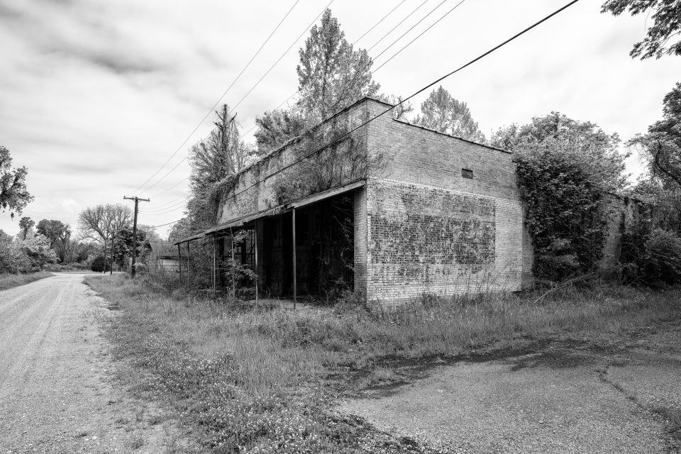 Abandoned R.C. Tibbs & Sons Building in Hushpuckena - Black and White Photograph by Keith Dotson. Buy a fine art print here.