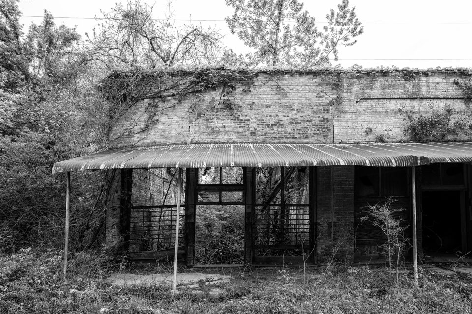 Hushpuckena Abandoned Storefronts, Black and white photograph by Keith Dotson. Click to buy a fine art print.