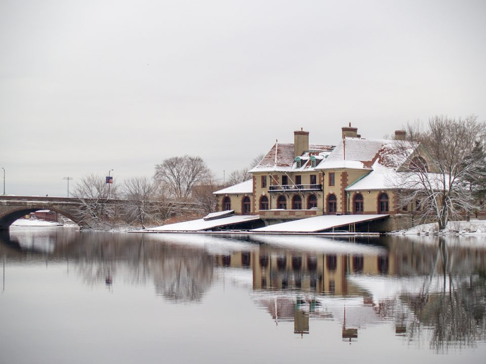 A view of Harvard's Weld Boathouse, reflecting in the placid Charles River. Photograph shot on New Years Day in 2006.