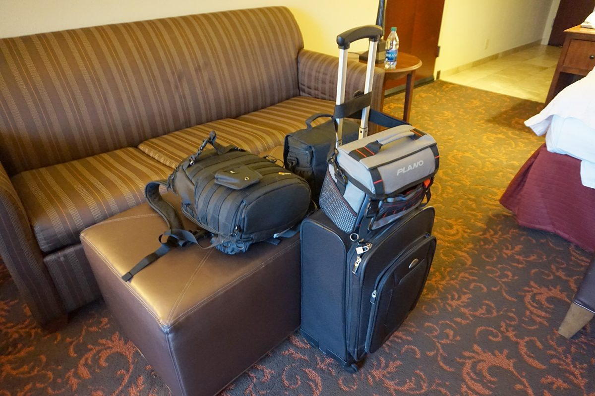 Photograph of camera bags and luggage in a hotel room