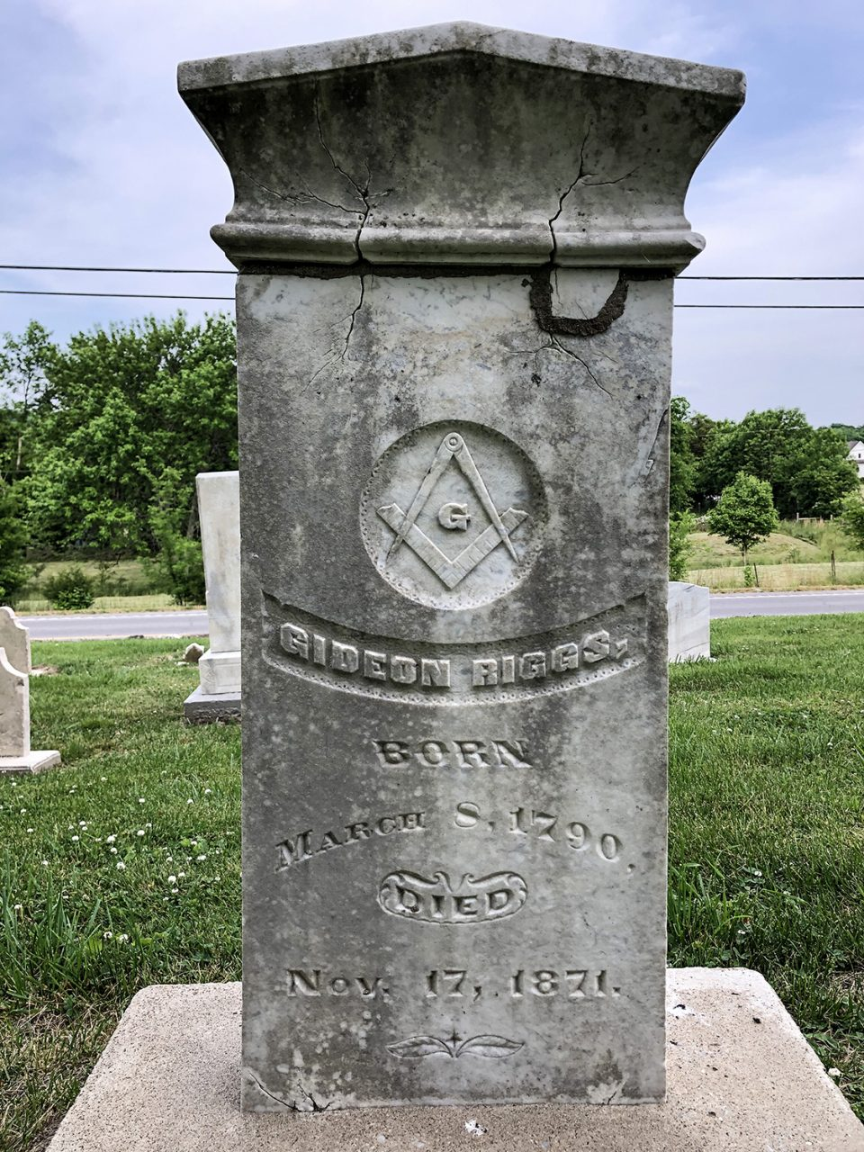 Tombstone for Gideon Riggs, former postmaster of the community as well as patriarch and namesake of the crossroads and the cemetery, buried 1871.