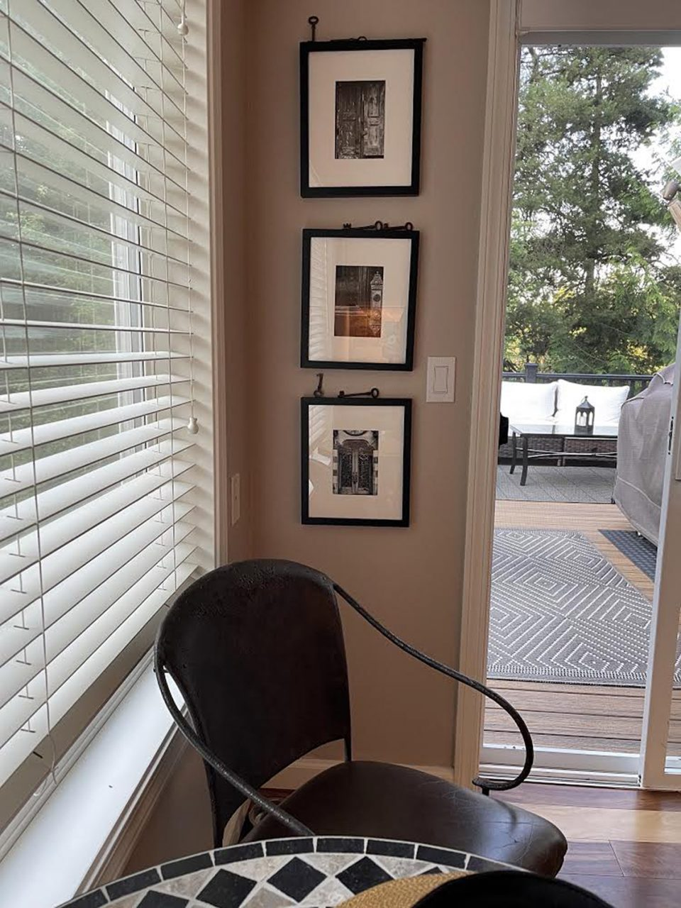 Three small prints by Keith Dotson shown framed on the wall of a home in Portland, Oregon.