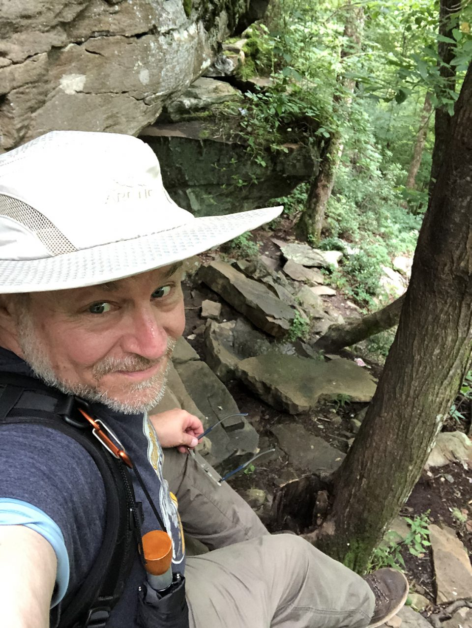 Yours truly, sitting on a big boulder just before a shimmy down. The rock shelter is just to my immediate left.