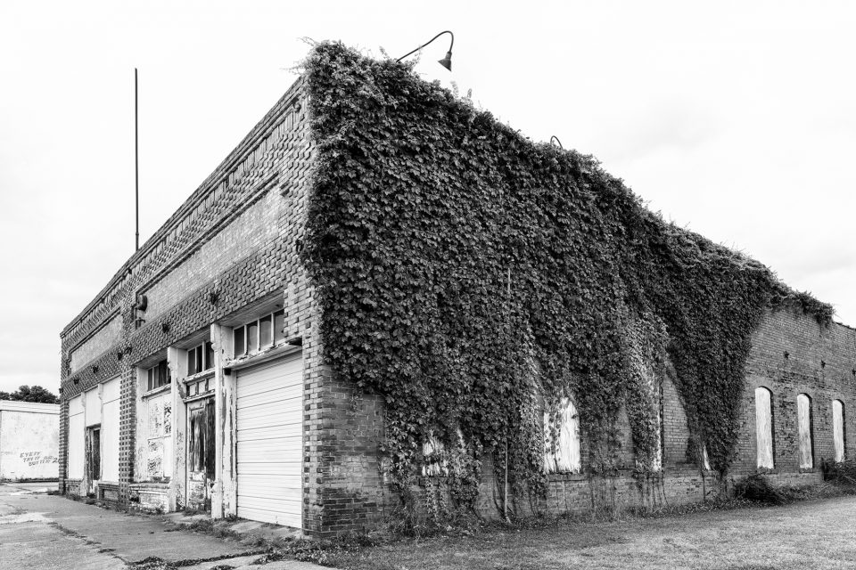 Black and white photograph of the abandoned Cullander Machinery Company building in Belzoni, Mississippi. Fine art prints available.