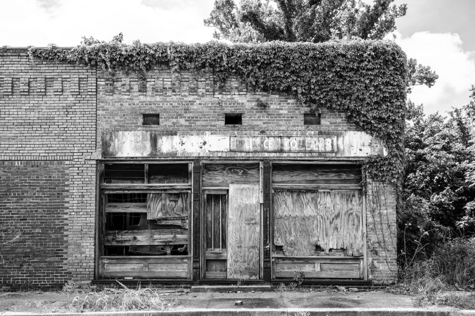Black and white photograph of an abandoned storefront in Clarksdale, Mississippi. Buy a fine art print.