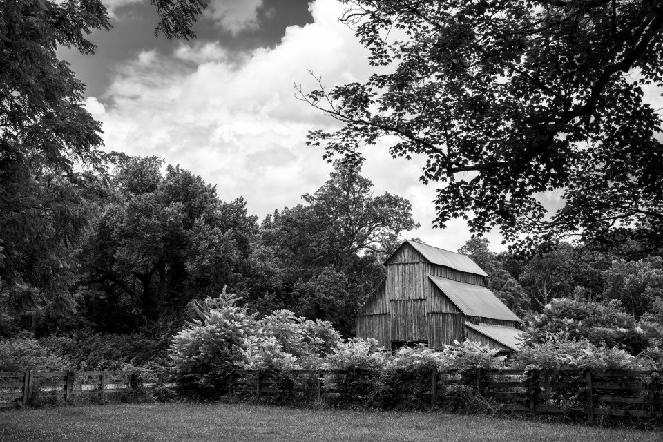 Black and white photograph of a beautiful red barn, by Keith Dotson. Fine art photographic prints are available.