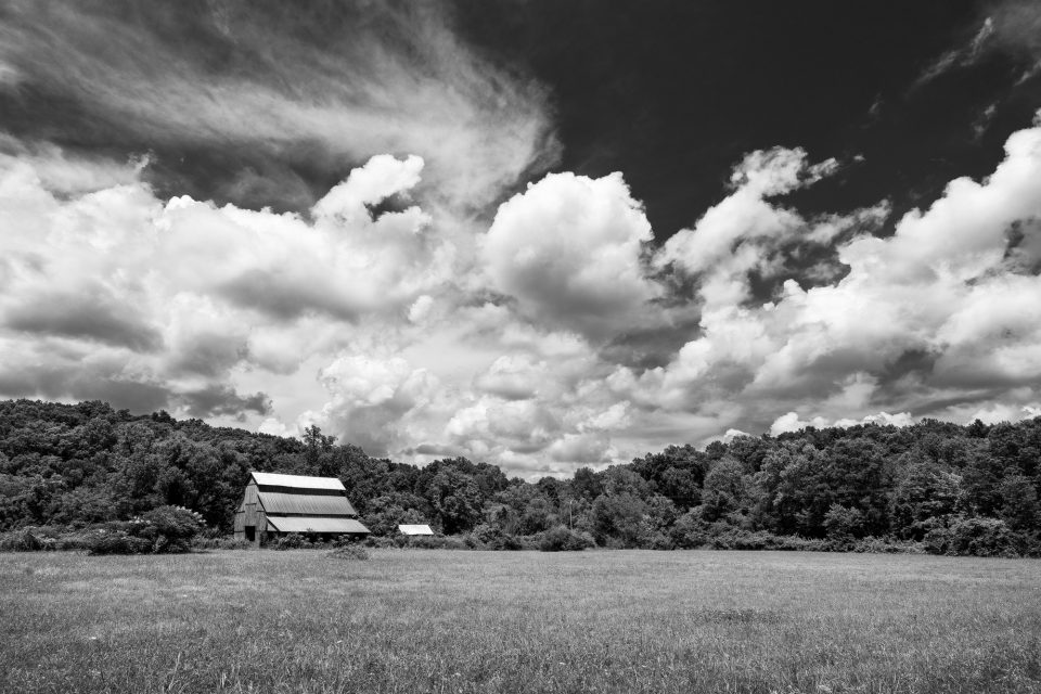 Barn and Big Sky, black and white photograph by Keith Dotson. Buy a fine art print.