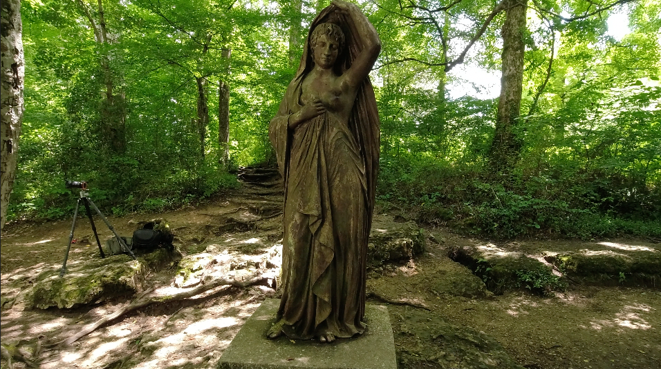 Photograph of the Lady of the Falls, a statue seen overlooking Rutledge Falls in Tennessee. She originally stood on the steps of the State Capitol in Nashville in the 1860s.