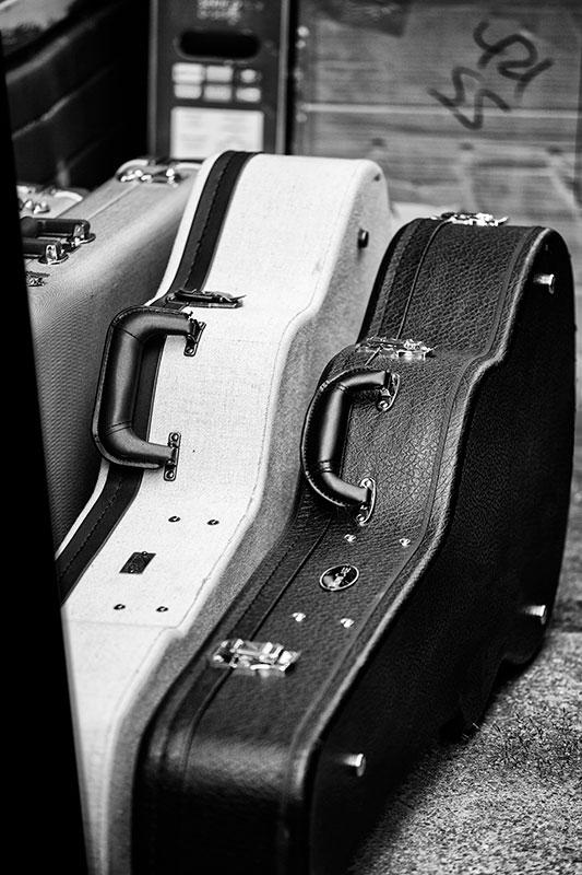 Keith Dotson's black and white photograph of guitar cases seen at a gig in Nashville