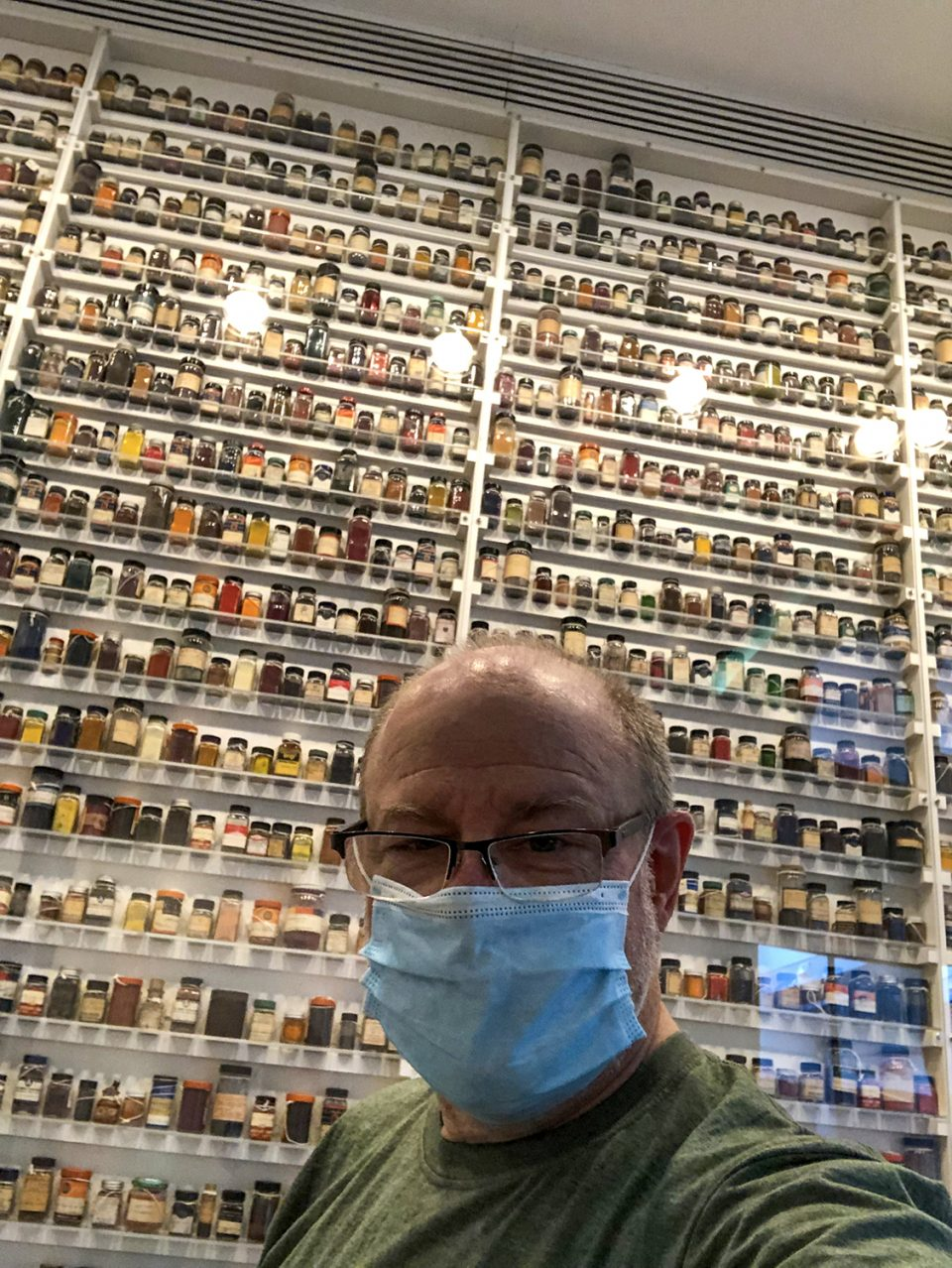 Selfie in front of the huge display of color dyes that were explored to create the look of Technicolor for movies, at the George Eastman Museum in Rochester, N.Y., August 2021.
