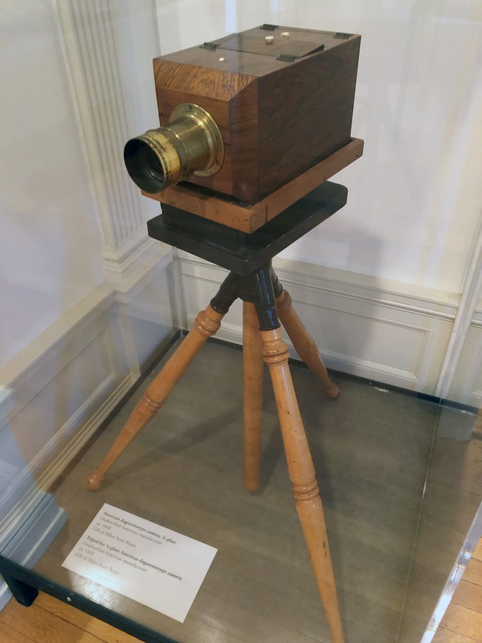 American Daguerreotype camera on a tripod, seen inside one of the rooms of the mansion.